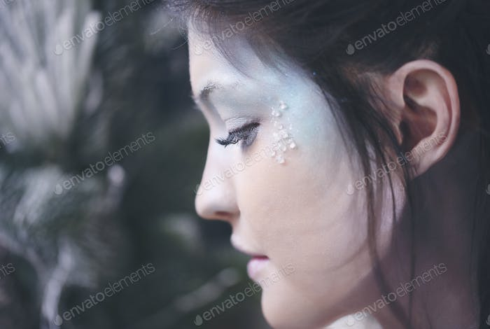 Part of ice queen's human face