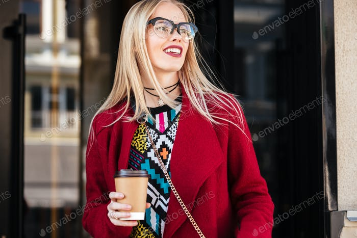 Attractive young caucasian woman walking outdoors.