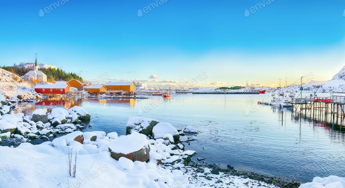 Amazing winter scenery of Moskenes village with ferryport and famous Moskenes parish Churc