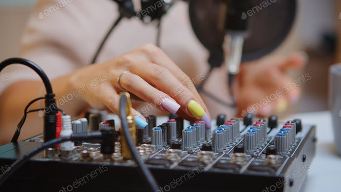 Checking sound on dj mixer