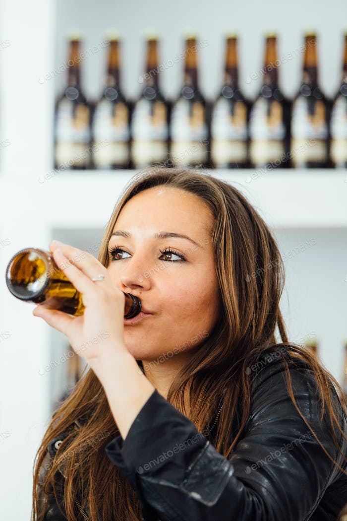 Woman drinking bottle beer