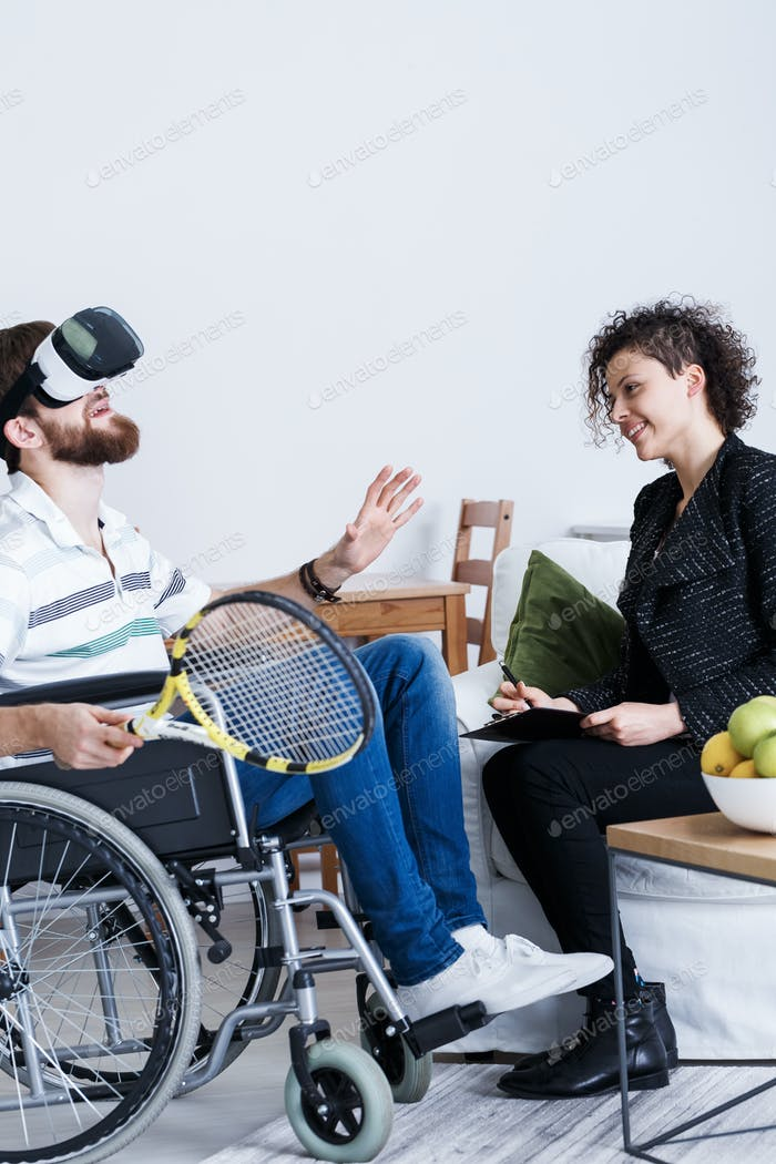 Man in VR with tennis racket