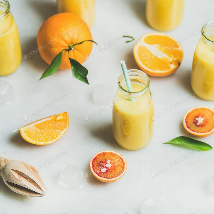 Healthy yellow smoothie with citrus fruit, square crop