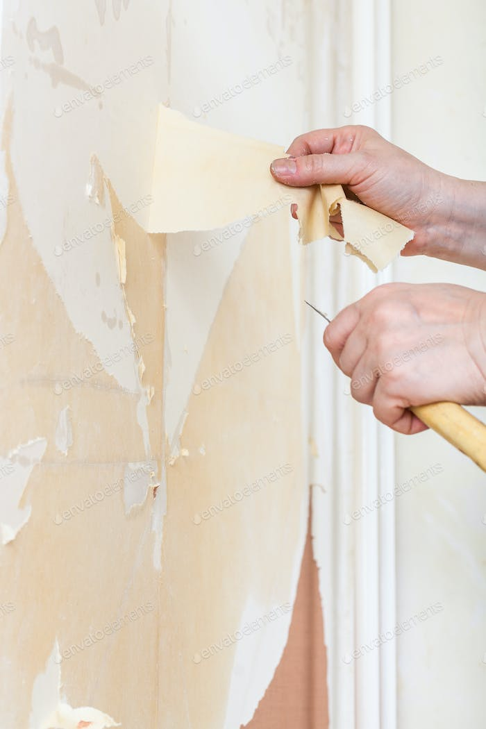 Removing of wallpaper backing from the wall