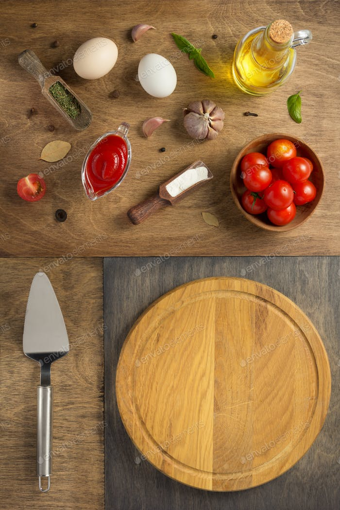 pizza food ingredients and cutting board