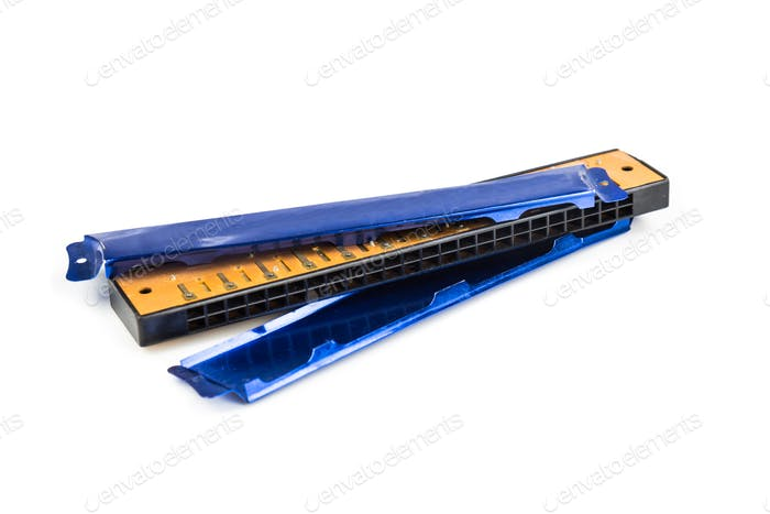 Broken harmonica cover plate isolated in white background