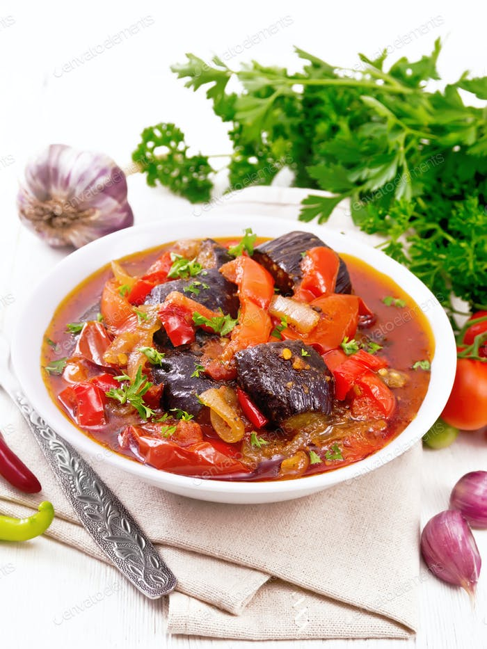 Ragout vegetable with eggplant on wooden board