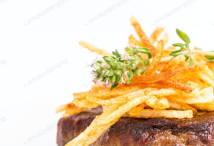 Delicious tenderloin steak with french fries.