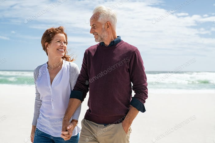 Loving mature couple at beach