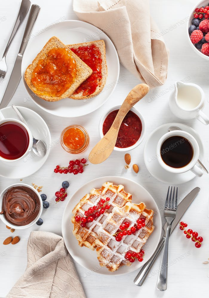 breakfast with waffle, toast, berry,  jam, chocolate spread and