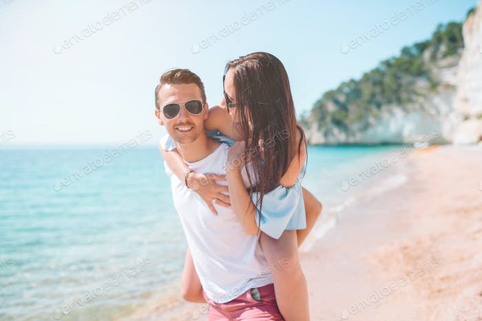 Young couple on white beach during summer vacation