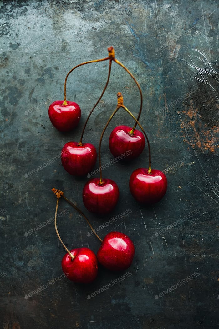 Ripe cherries on grunge background