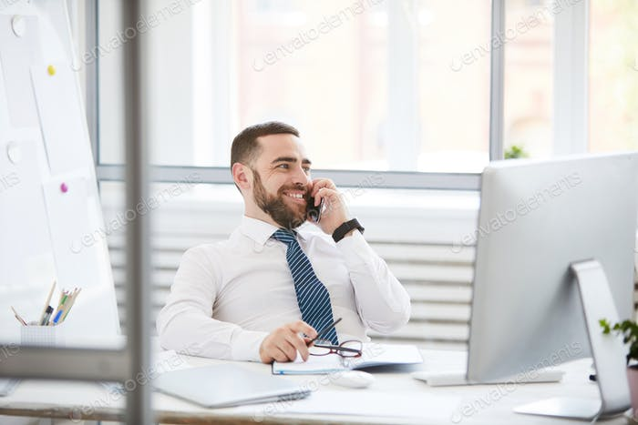 Confident manager communicating on phone