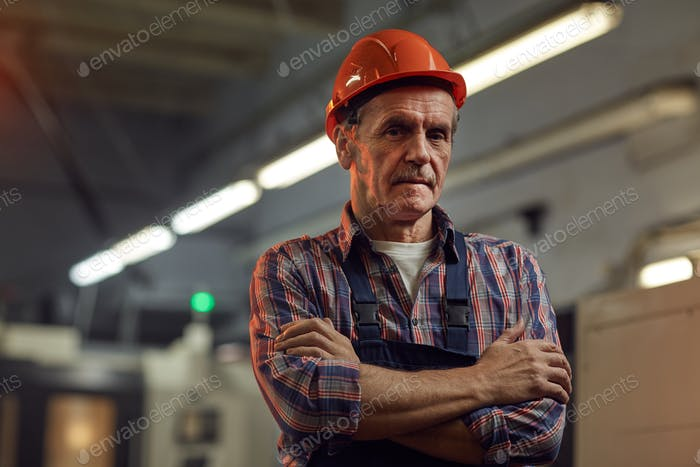 Foreman in work wear in the plant