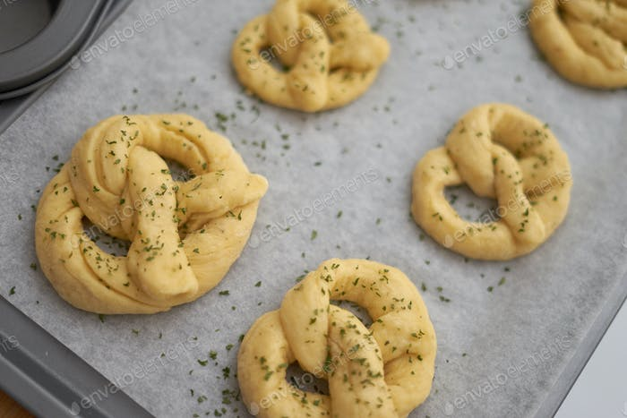Twisted dough arranges in baking tray