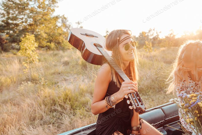 A girl with a guitar in the car