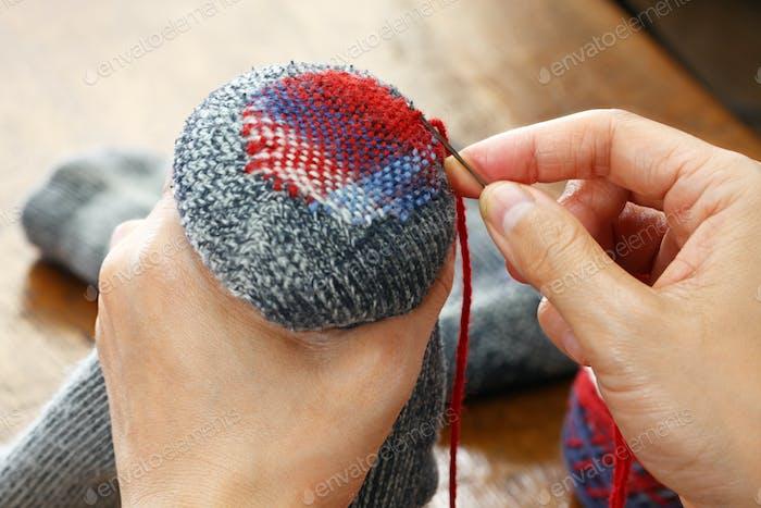 darning socks, repairing holes in socks