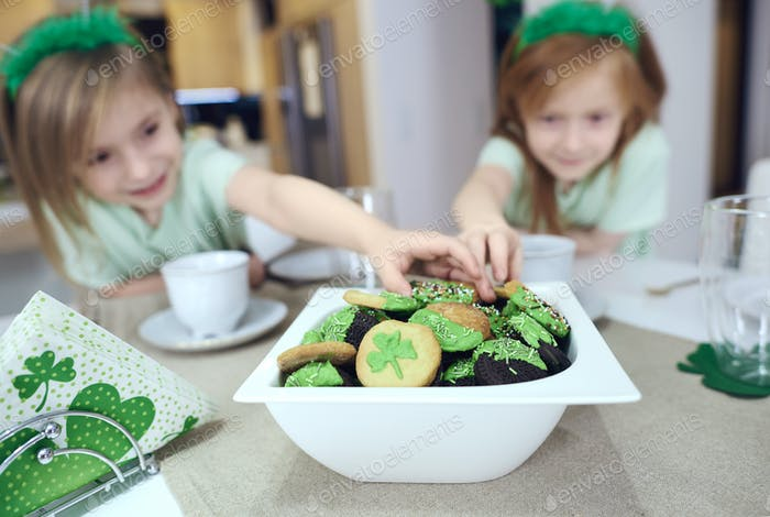 Defocused girl reaching for cookies