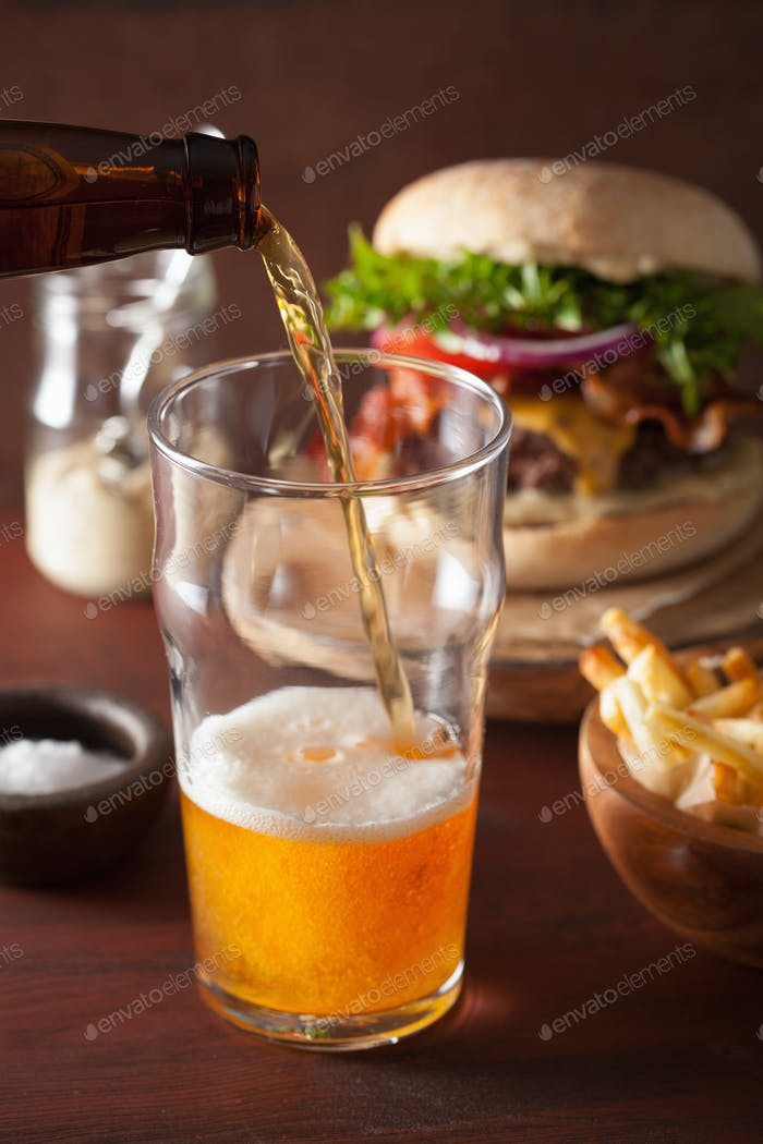 pouring india pale ale beer into pint glass and fastfood