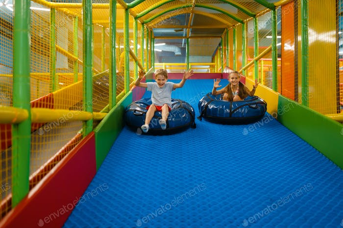 Children rides on tubing, entertainment center
