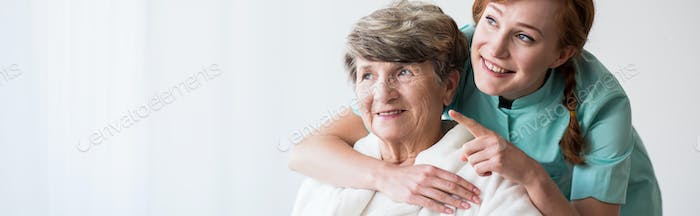 Thumbnail for Caregiver and older happy woman
