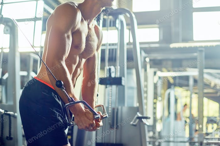 Bare Handsome Man Exercising in Gym