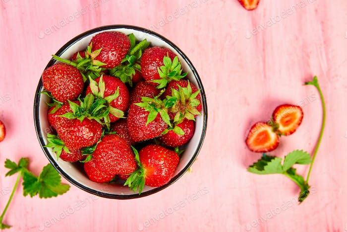 Strawberries in red bowl. Fresh strawberries. Beautiful strawberries.