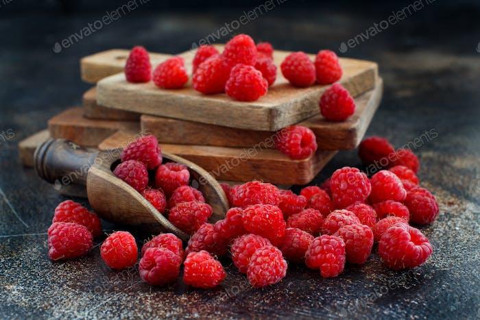 Fresh raspberries on a dark background