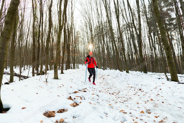 Woman Trail Running in Winter.