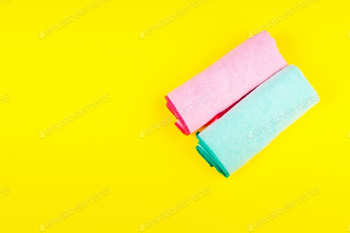 Colorful microfiber cloths on bright yellow