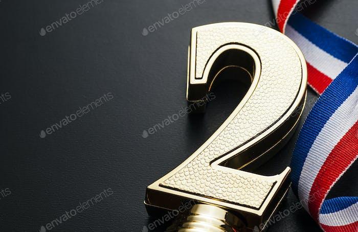 Premio número dos de oro o trofeo de premio