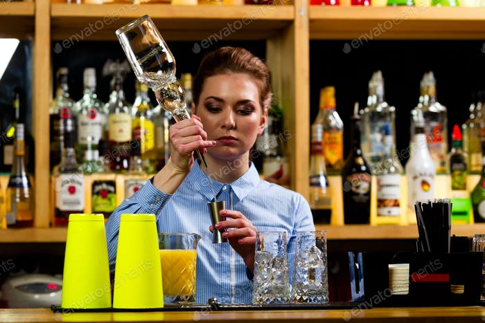 The bartender prepares cocktails at the bar