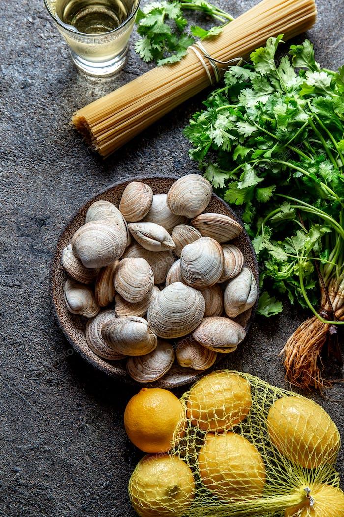 Shellfish seafood clams almejas with cilantro, pasta, lemon and white whine.