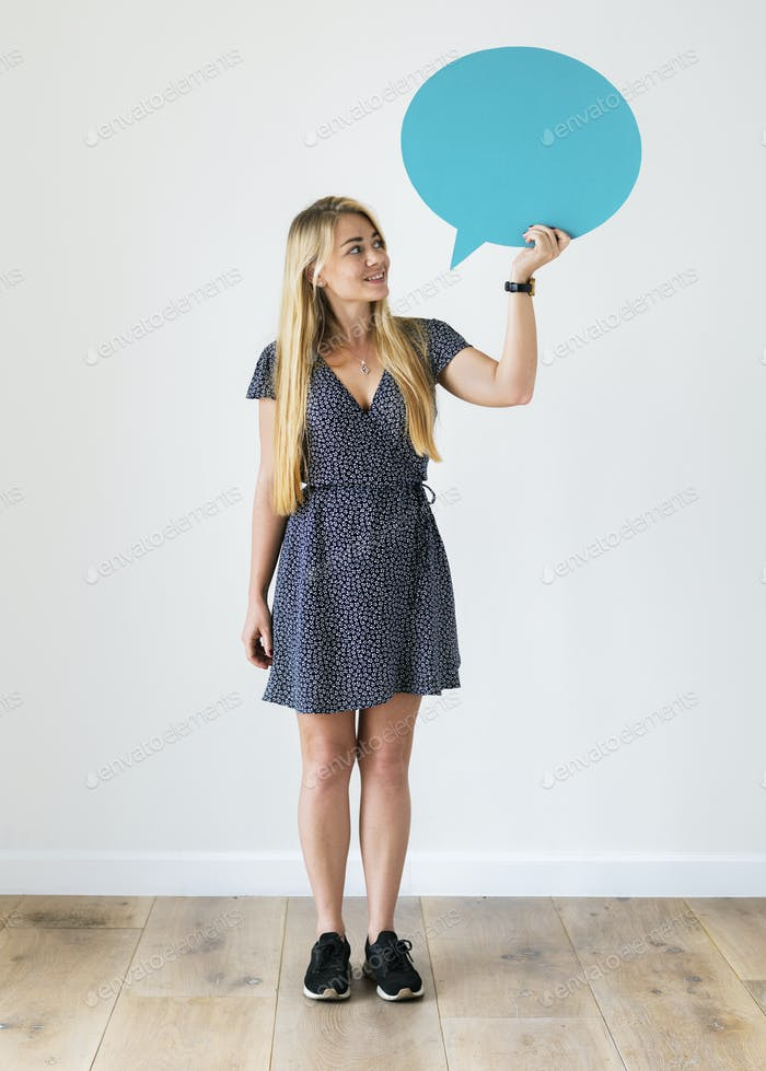Happy Caucasian woman holding copyspace speech bubble