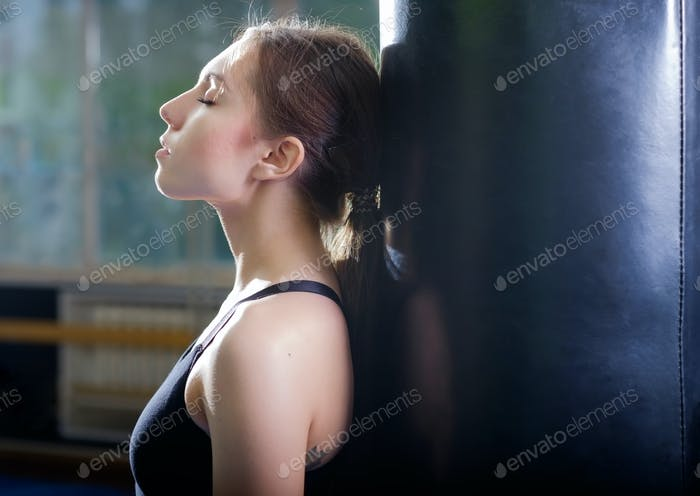 Young boxing girl dreaming about future