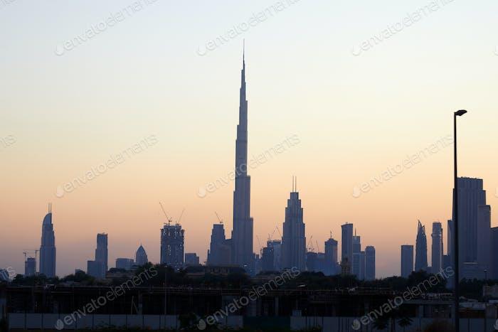 Dubai skyline with Burj Khalifa skyscraper at sunset, clear sky in United Arab Emirates