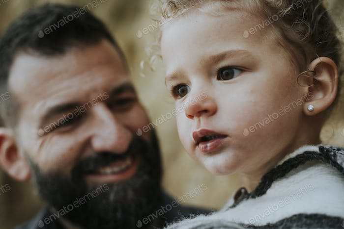 Portrait of daughter and father
