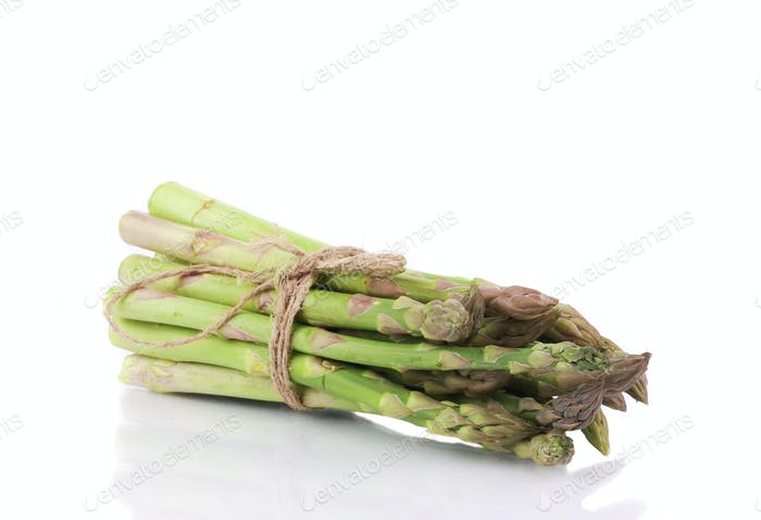 Asparagus tied on the white background.