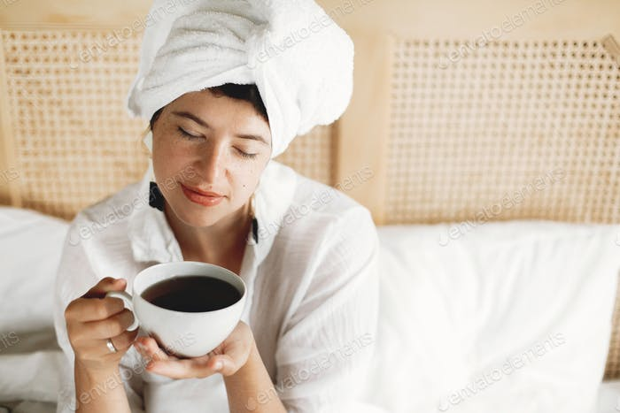 Fashionable  brunette girl with white towel enjoying morning