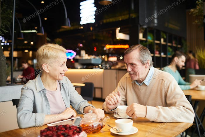 Mature couple have a date in cafe