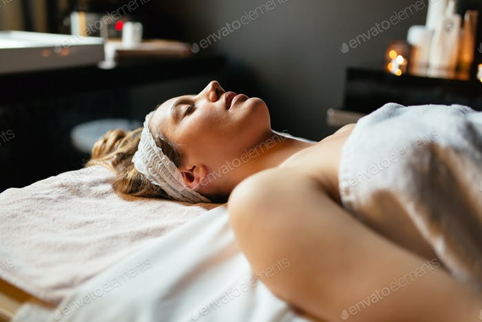 Beautiful woman lying on massage table