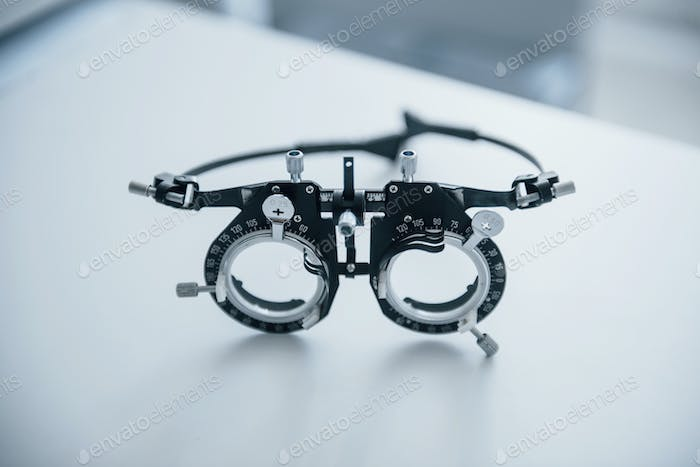 Diopter is on the white table. Close up view of single object