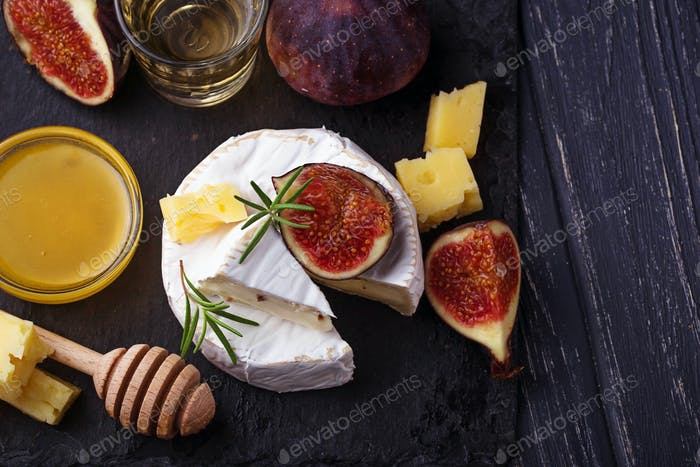 Camembert cheese with  figs, honey and wine