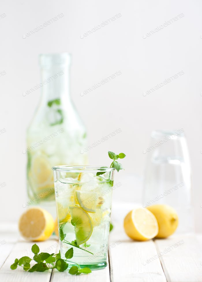 Lemonade lemonade in a glass cup on a white wooden table.