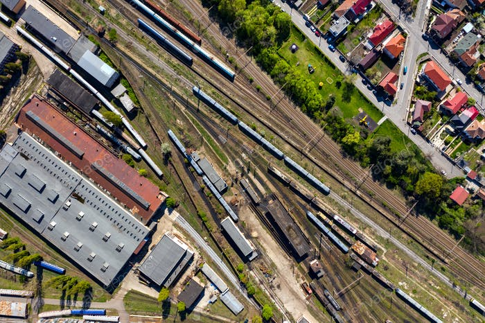 Aerial drone view of old locomotive train depo, parking iron horses on railway routes