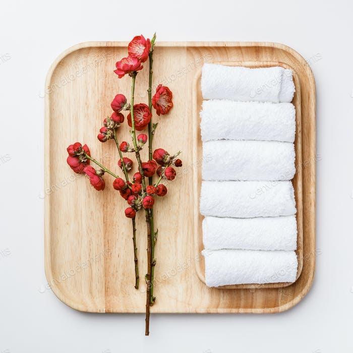 Spa treatment concept, flat lay composition with towels and flow
