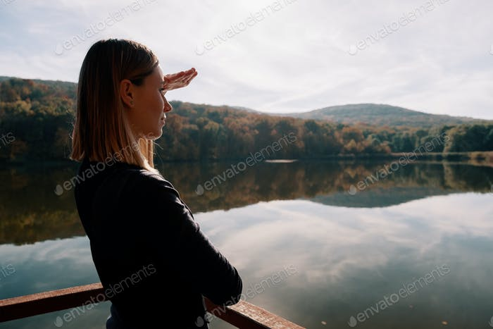 Beautiful woman enjowing landscape view
