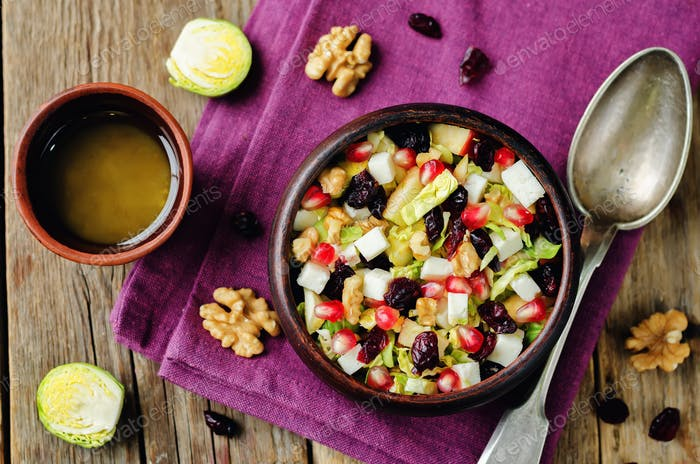 Shredded brussel sprout apple dried cranberry walnuts salad