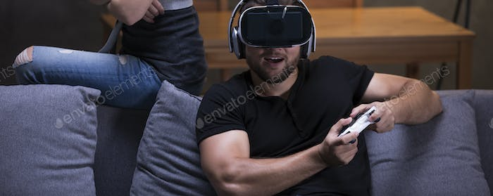 Man playing video games with offended partner