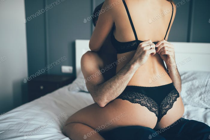 Attractive happy couple resting together in bedroom